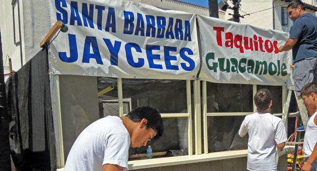 <p>Fiesta&#8217;s Mercados went up Tuesday in preparation for Wednesday&#8217;s opening. In De la Guerra Plaza, student wrestlers from San Marcos High School put finishing touches on the Santa Barbara Jaycees booth, which will sell taquitos, guacamole, slushies and more.</p>