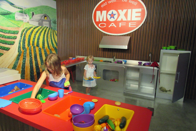 "Ansley and Kaitlyn Scherer play in the Moxie Cafe exhibit at the Santa Maria Valley Discovery Museum where plastic fruits and vegetables let kids serve up fake but healthy foods. The museum next week will host the ""Food Is Fun!"" summer cooking camp."