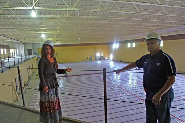Ice in Paradise fundraising campaign manager Jennifer Ono and general manager Larry Bruyere show off the main NHL-sized rink at the nearly-complete facility.