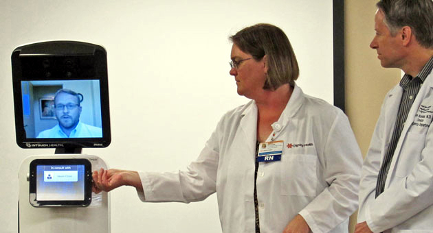 <p>Jason Close demonstrates Sheldon&#8217;s video capabilities as registered nurse Kirsten Featherstone and Dr. David Ketelaar watch at Marian Regional Medical Center in Santa Maria.</p>