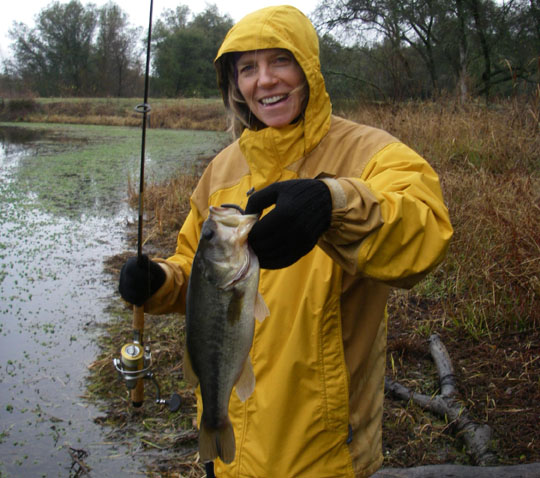 <p>Angler Amanda Menefee shows off her catch, a largemouth bass. The Northern or Florida strain of largemouth bass are the best species for stocking small private ponds.</p>