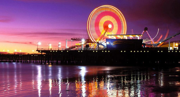 <p>The Santa Monica Pier, aglow at night, features the world's only solar-powered Ferris wheel.</p>