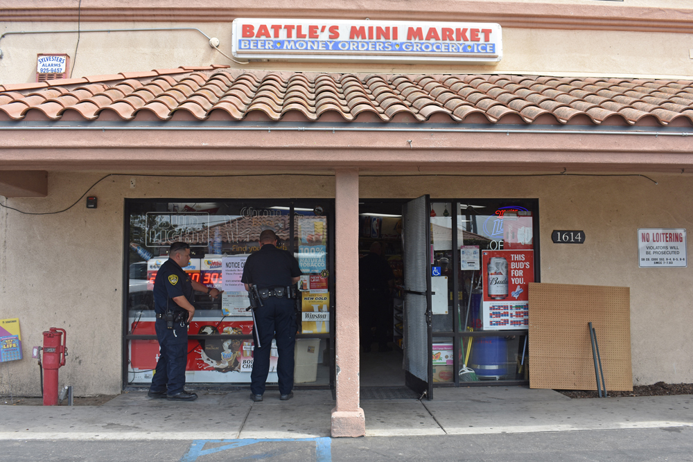 Santa Maria police post a notice of revocation sign at Battles Mini Market on South McClelland Street on Tuesday to alert customers the business lost its license to sell alcohol.