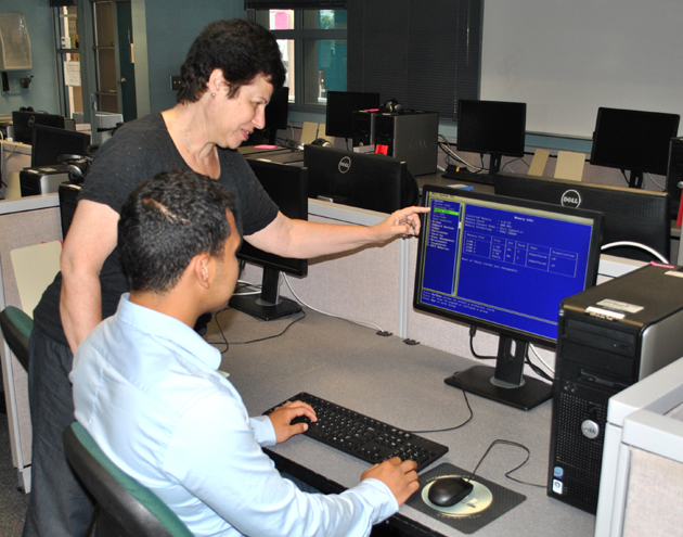 <p>SBCC professor Esther Frankel discusses a question with student Raul Ochoa in one of the college's IT Academy certification courses.</p>