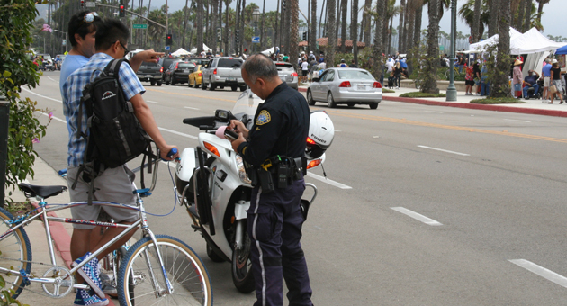 That'll be two tickets in Paradise for these two bicycle scofflaws. (Frankie Victoria / Noozhawk photo)