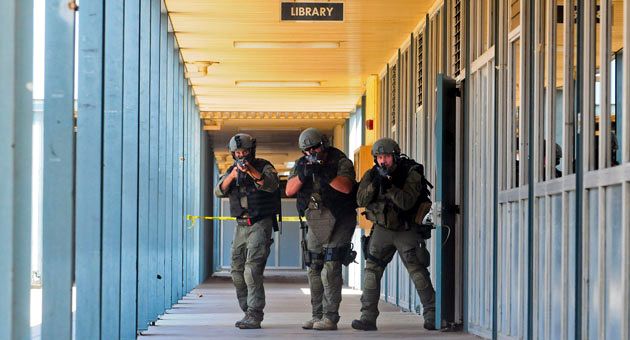 <p>Sheriff&#8217;s Special Enforcement Team members move through Dos Pueblos High School&#8217;s hallways on Wednesday as part of an active shooter drill.</p>