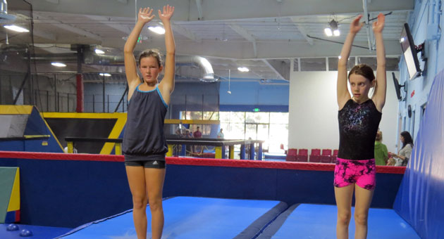 <p>Students in an advanced air class at Cloud 10 Jump in Goleta prepare for back-hand spring jumps. Participants included 12-year-old Kylee Heather, left, and 10-year-old Meggie Young.</p>