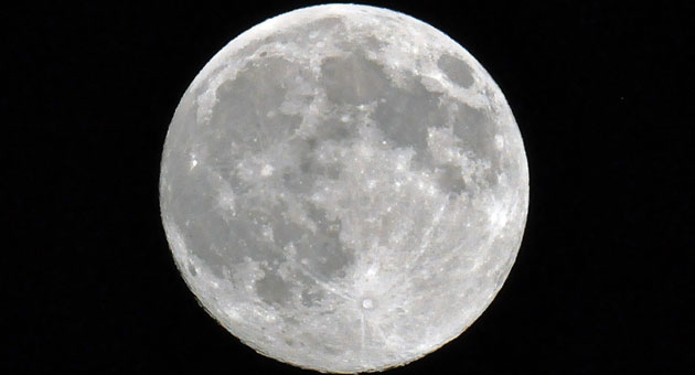 "<p>Saturday night offered a prelude to the ""super moon"" expected Sunday night.</p>"