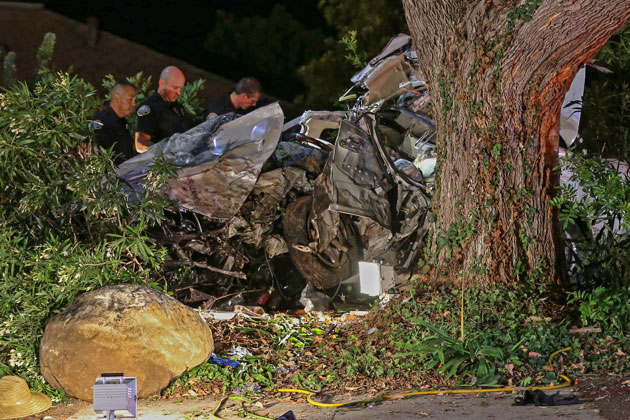 Santa Barbara police officers investigate a crash on the Mesa Tuesday night that left three people dead and another critically injured.