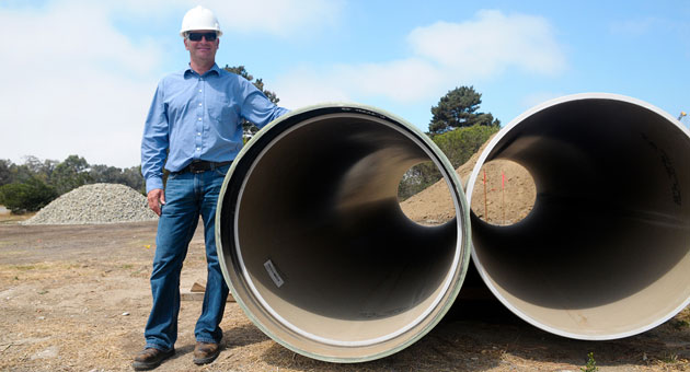 <p>Goleta West General Manager Mark Nation stands with the sewer pipes ready to be installed Monday as part of the $9.5 million project to replace the sanitary district&#8217;s main pipeline.</p>