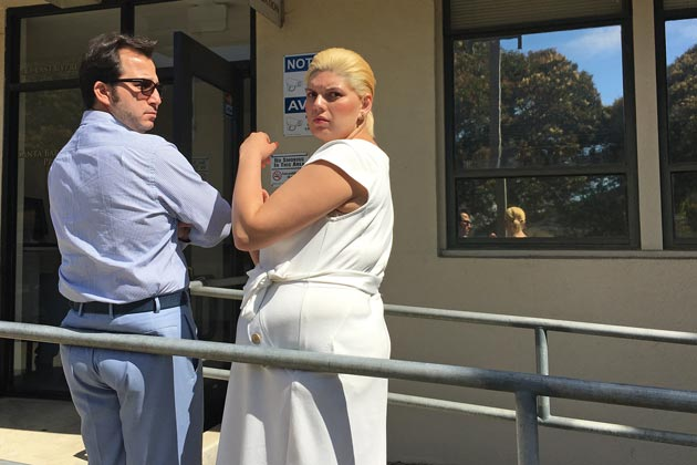 Anthony Lee Davis and Gina Lucyfenia Lee stand outside the Probation Office after being sentenced for a Lompoc psychic scam in court Friday.