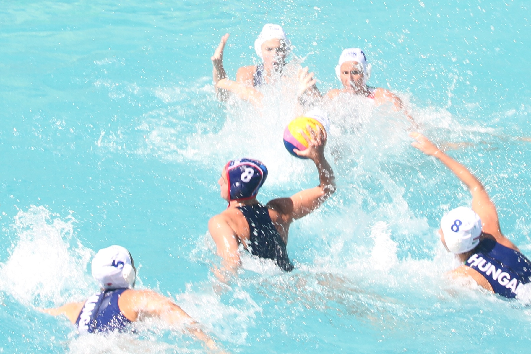 Kiley Neushul beats Hungary's Rita Keszthelyi en route to scoring the third goal for Team USA.
