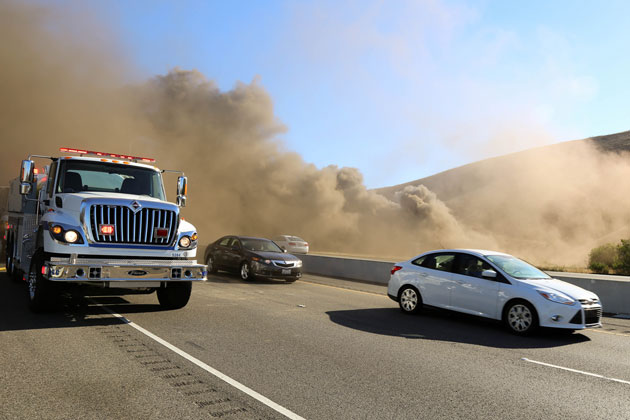 Smoke billows over Highway 101 near the Nojoqui Summit on Sunday afternoon after a vegetation fire broke out. Initial reports were that 15 acres had been charred.