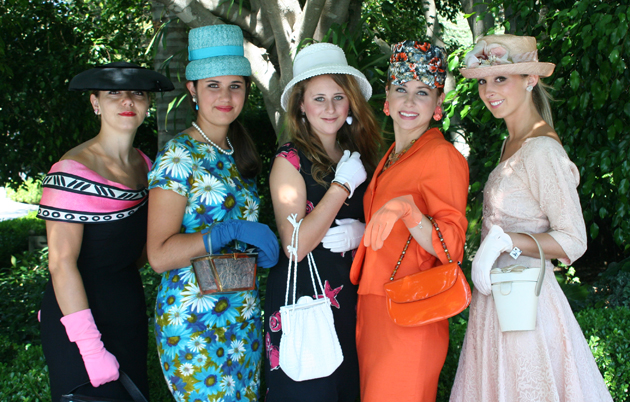 Young models dressed in 1960s attire from the Paris Street Boutique and inspired by the late Jacqueline Kennedy strolled across the grounds Saturday afternoon for the Angels Bearing Gifts Ladies Tea fundraiser.