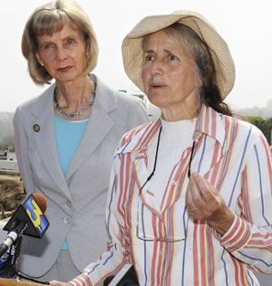 Rep. Lois Capps, left, listens as Eva Inbar of the Coalition for Sustainable Transportation speaks out against the legislation.