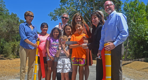 <p>Santa Barbara County and school district officials cut the ribbon Monday on the new paved pathway linking nearby families to El Camino Elementary and San Marcos High schools.</p>