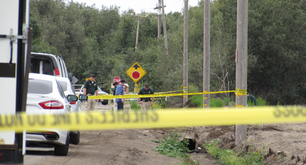 <p>Invesigators search for clues on West Main Street near Guadalupe Beach Tuesday after a body was found in what sheriff&#8217;s officials were describing as a &#8220;suspicious death.&#8221; The remains were found behind the right utility pole.</p>