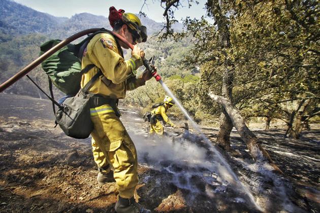 Cal Fire firefighters from Monterey County Sal Mercurio, left, and Stuart Cardoza put out hot spots as crews continue to battle the Cuesta Fire Wednesday.