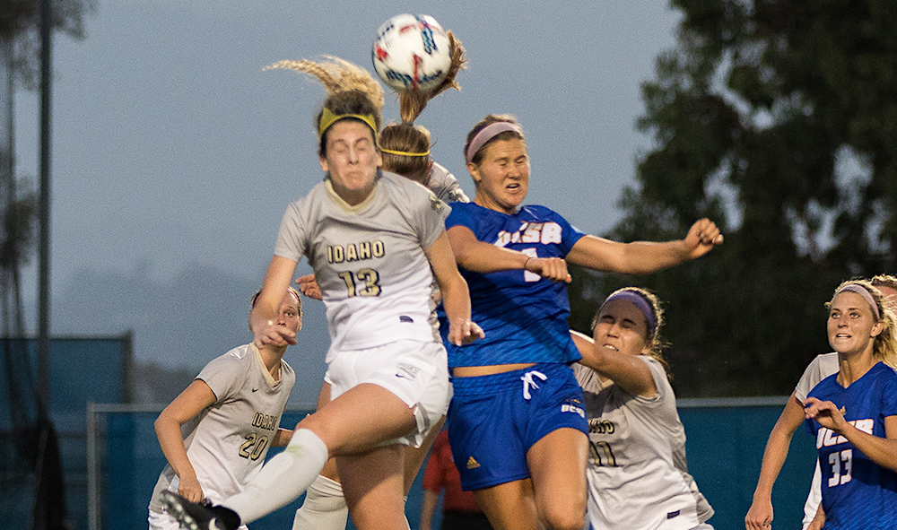 Kate Shoemaker of UCSB battles with Idaho's Taylor Brust for a head ball during Friday night's season-opening soccer match at Harder Stadium.