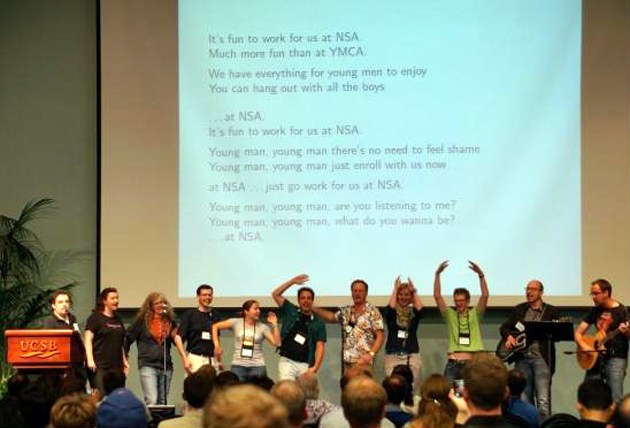 <p>A little levity to break up the seriousness: Participants dance and sing their own song to the tune of The Village People&#8217;s &#8220;YMCA&#8221; at this week&#8217;s CRYPTO 2014 conference at UCSB.</p>