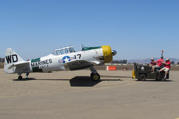 Four Stars Auto Ranch >> A vintage aircraft is towed into position at the Santa ...