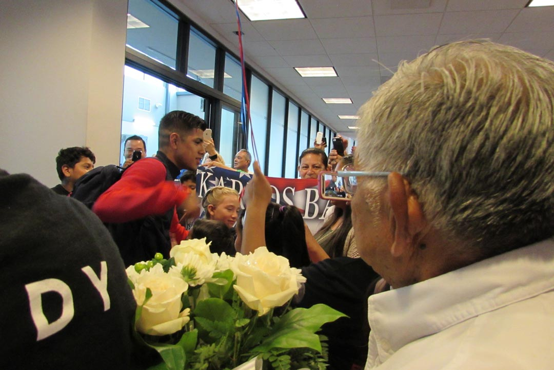 A huge group of well-wishers greets Olympic boxer Carlos Balderas as he returns to Santa Maria from Rio.