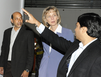 Rep. Lois Capps, D-Santa Barbara, takes a tour on Tuesday of Transphorm's factory in Goleta with company executives Umesh Mishra, left, and Primit Parikh.