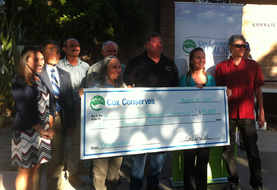 <p>Rebecca Claassen, second from right, accepts her $15,000 Cox Conserves Hero Award on Monday night for her work as a founder of the Santa Barbara County Water Guardians.</p>