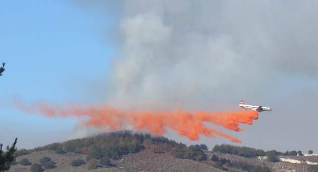<p>An air tanker drops a load of retardant on a brush fire burning on Harris Grade near Lompoc Wednesday afternoon.</p>