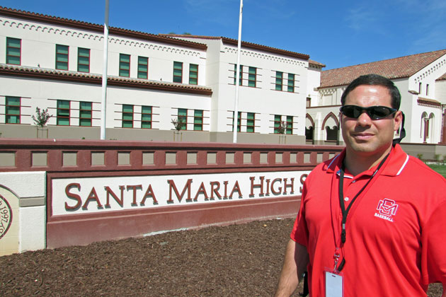 Santa Maria High School Principal Joe Domingues, who graduated from the school in 1993, stands in front of the new two-story classroom building on the campus.