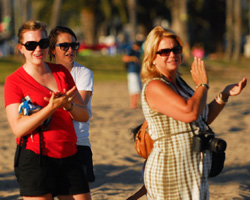 Some people prefer to stay on the beach to cheer on the Nite Moves athletes.