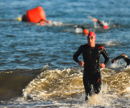 Nite Moves draws hundreds of athletes to Leadbetter Beach each Wednesday through the summer for swim and run events.