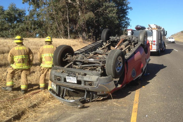 Santa Barbara Fire Battalion Chief Robert Mercado escaped serious injury Saturday when his department vehicle overturned on Highway 101 near Gaviota.