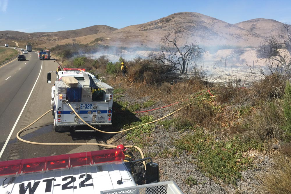 Santa Barbara County Fire Department crews, a county helicopter and a strike team from the Rey Fire responded to a vegetation fire north of Los Alamos Monday afternoon.