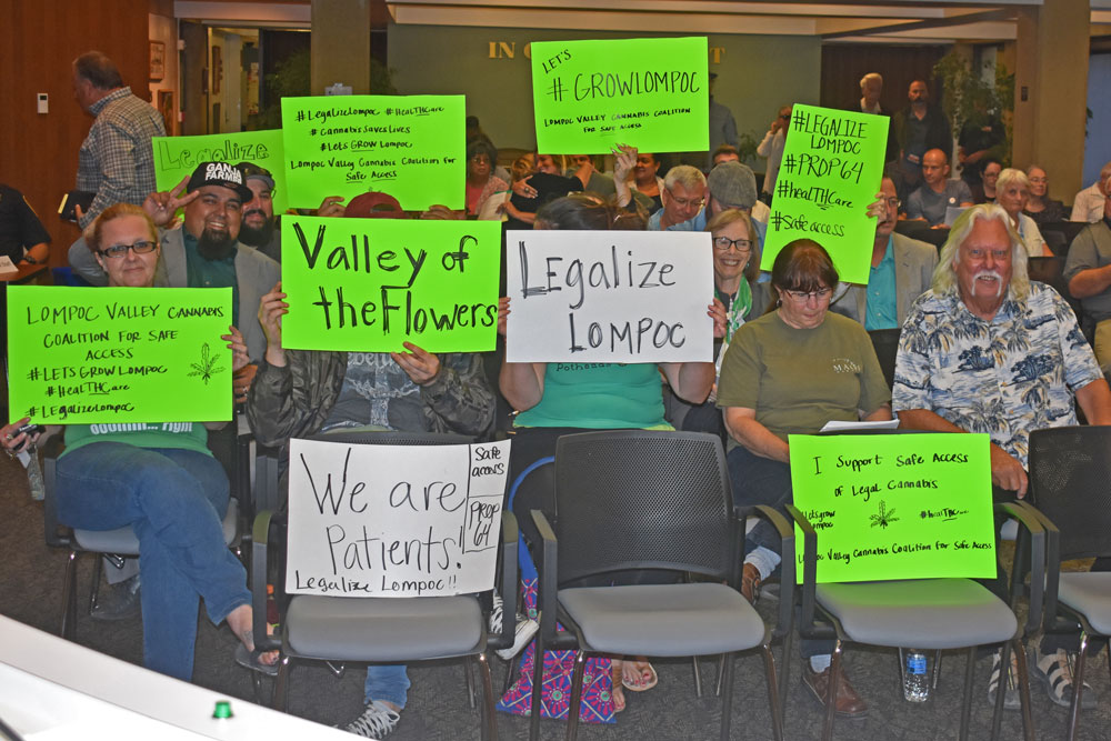 Some 75 people, many carrying signs, attended a special Lompoc City Council meeting on marijuana regulations Tuesday night.