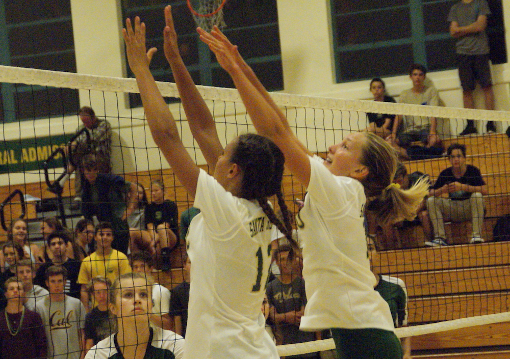 Reece Kelley, left, and Linnea Skinner of Santa Barbara combine on a block during match against Thousand Oaks