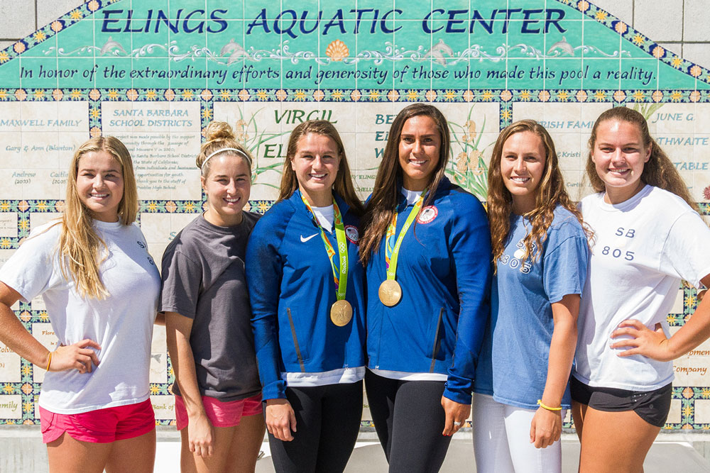 Olympic gold medalists (center, left) Kiley Neushul and (center right) Sami Hill, are joined by their siblings on the Dos Pueblos pool deck. At the left of Kiley are her sisters Ryann and Jamie Neushul. Alongside Sami are Kodi and Abbi Hill.