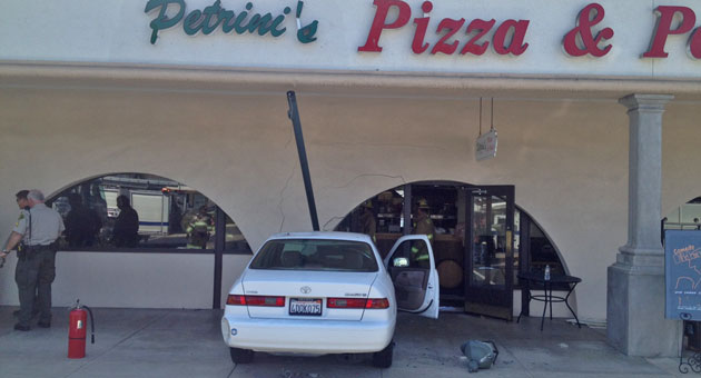 Take out the food, not the wall! No one was injured when this car crashed into Petrini's Italian Restaurant, 5711 Calle Real in Goleta. (John Palminteri / KEYT News photo)