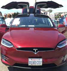 The license plate makes a statement: XERO CO2 in a Tesla X Autopilot owned by Merkord family.