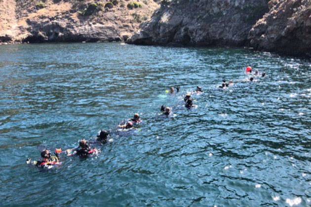 Divers search for bodies and evidence near Santa Cruz Island.