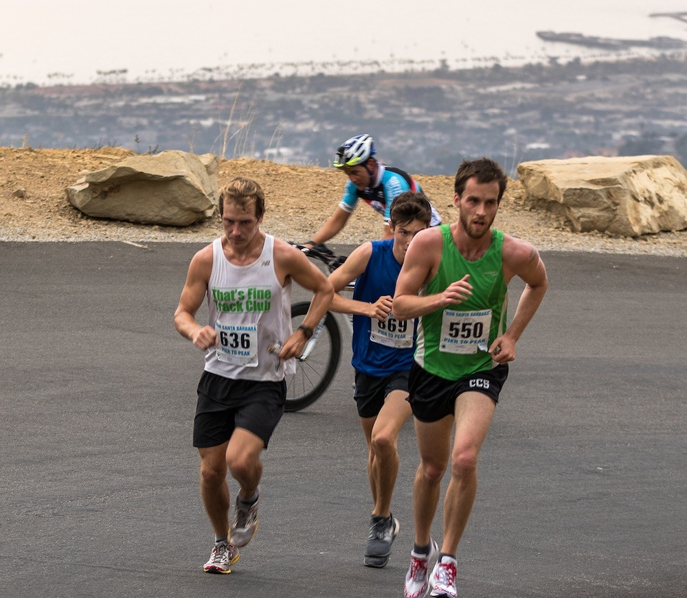 In the climb up Gibraltar Road, runners in the Pier to Peak Half-Marathon can see where they started the race.