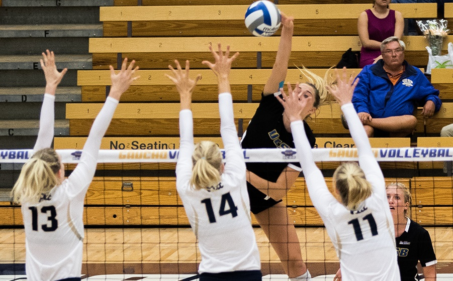 UCSB's Lindsay Ruddins hits over the triple block of Pitt's Stephanie Williams (13), Jenna Potts (14) and Kelsey O'Neill.