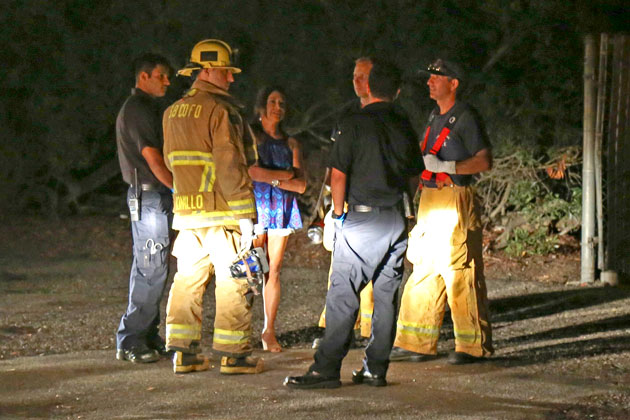 Paula Lopez Ochoa is interviewed by firefighters and paramedics Sunday night in Goleta prior to her arrest on suspicion of DUI and resisting and assaulting police officers.