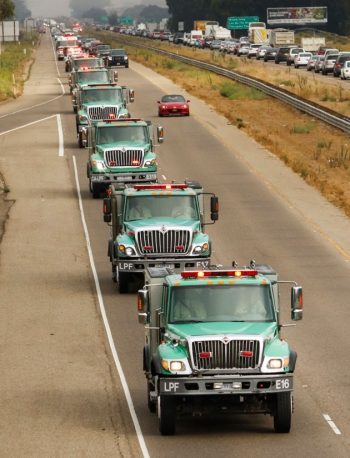 A somber yet impressive procession of U.S. Forest Service fire trucks heads down Highway 101 through Nipomo on Sept. 6, en route to the memorial service for fire Battalion Chief Gary Helming in Orcutt.