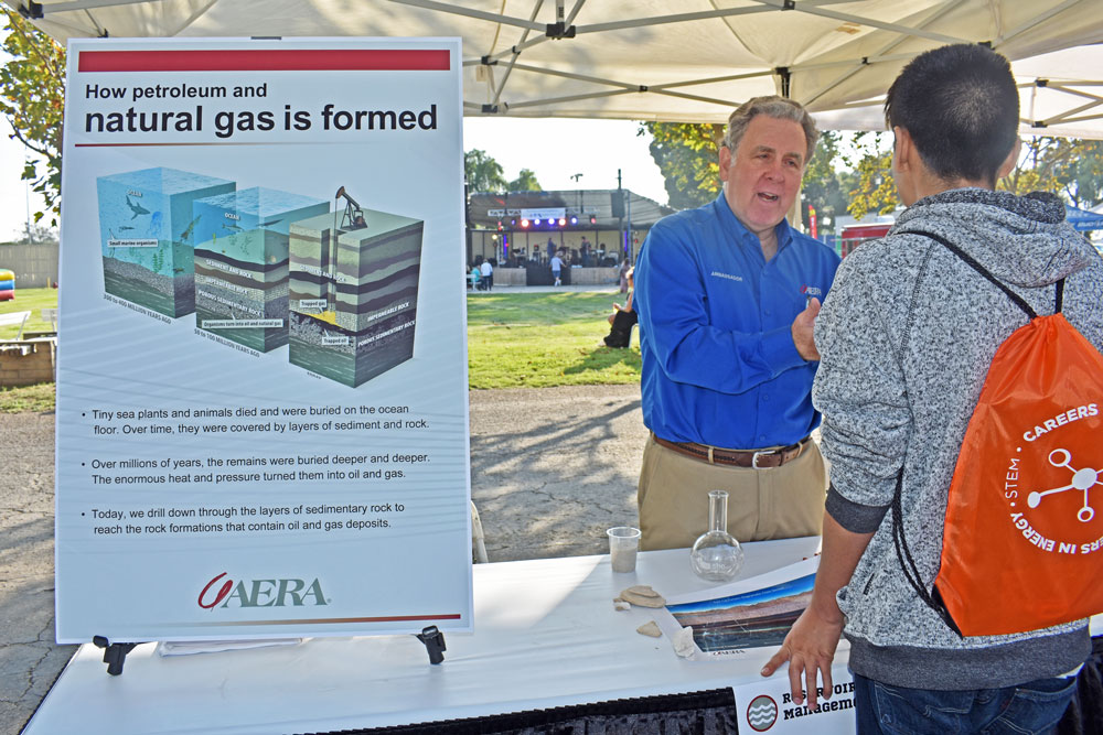 Aera Energy's Rob Fairman talks to a attendee at the Santa Maria Valley Chamber of Commerce's ExpoFest at the Santa Maria Fairpark. This year's annual business trade show expanded and included several booth from energy firms.