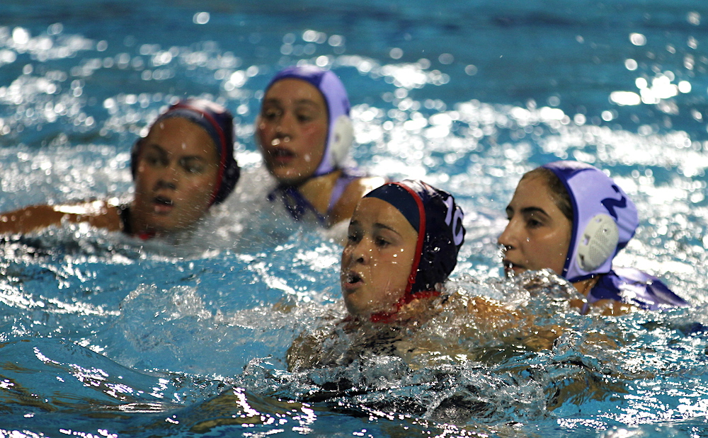 Team USA's Abbi Hill, left, and Ryann Neushul are closely guarded by Greece defenders during quarterfinal game at the FINA Women's Junior World Championship. Hill is a junior and Neushul a senior at Dos Pueblos.