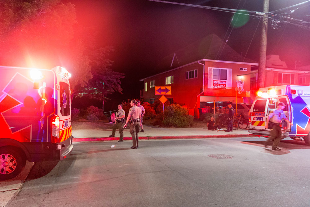 Two people, including a UC Santa Barbara police officer, were taken to the hospital late Saturday after two large fights broke out in Isla Vista.