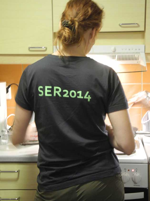 Anne Tolvnen, wearing her Society for Ecological Restoration T-shirt, cooks mushrooms we gathered.