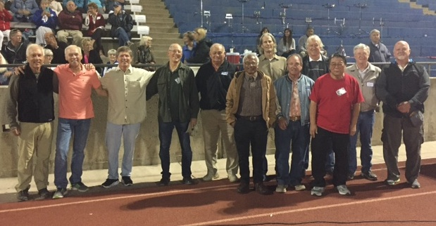 Members of the 1965 San Marcos football team were honored at Friday's game against Lompoc.