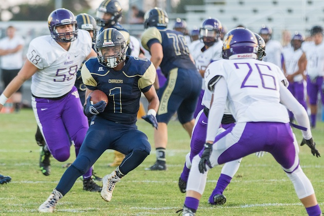 Dos Pueblos running back Irvin Miguel looks to make a move on Righetti's Elijah Burns as Jacob Rothanzi of the Warriors gives chase.